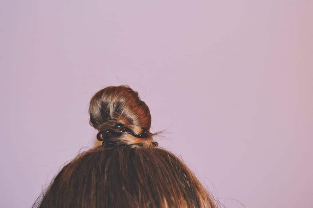 brown_haired_woman_with_brown_hair-messy_bun