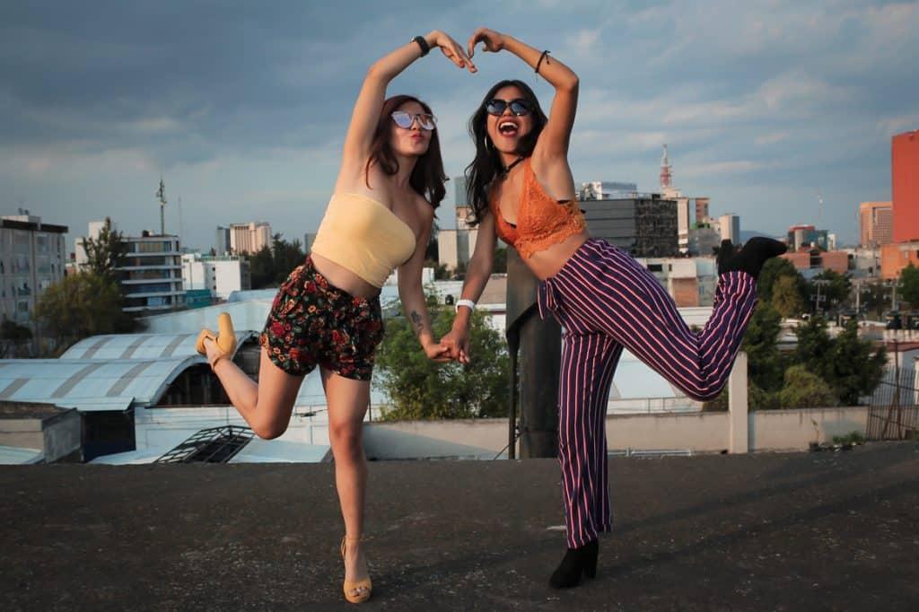 Two women standing on peak at daytime